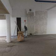 Bild under projektets gång målning av garage för bostadsrättsförening i Huskvarna